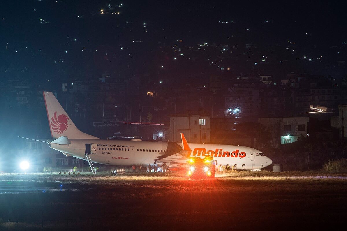 A Malindo Air Boeing 737-900 is stuck in the mud off the runway in Kathmandu after aborting takeoff on Thursday night, closing down the airport.