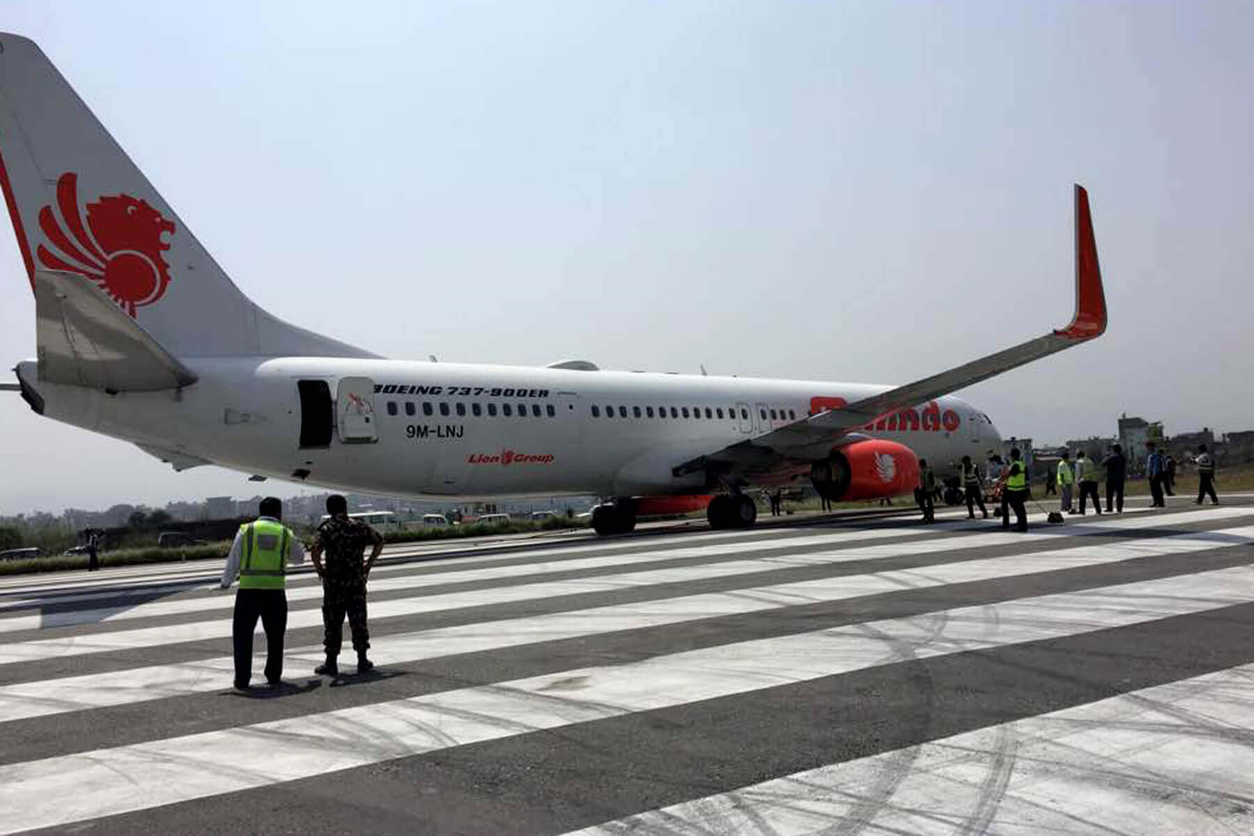 Malindo Air Boeing 737-900 that suffered a runway excursion in Kathmandu Thursday night being towed to the hangar area on Friday.
