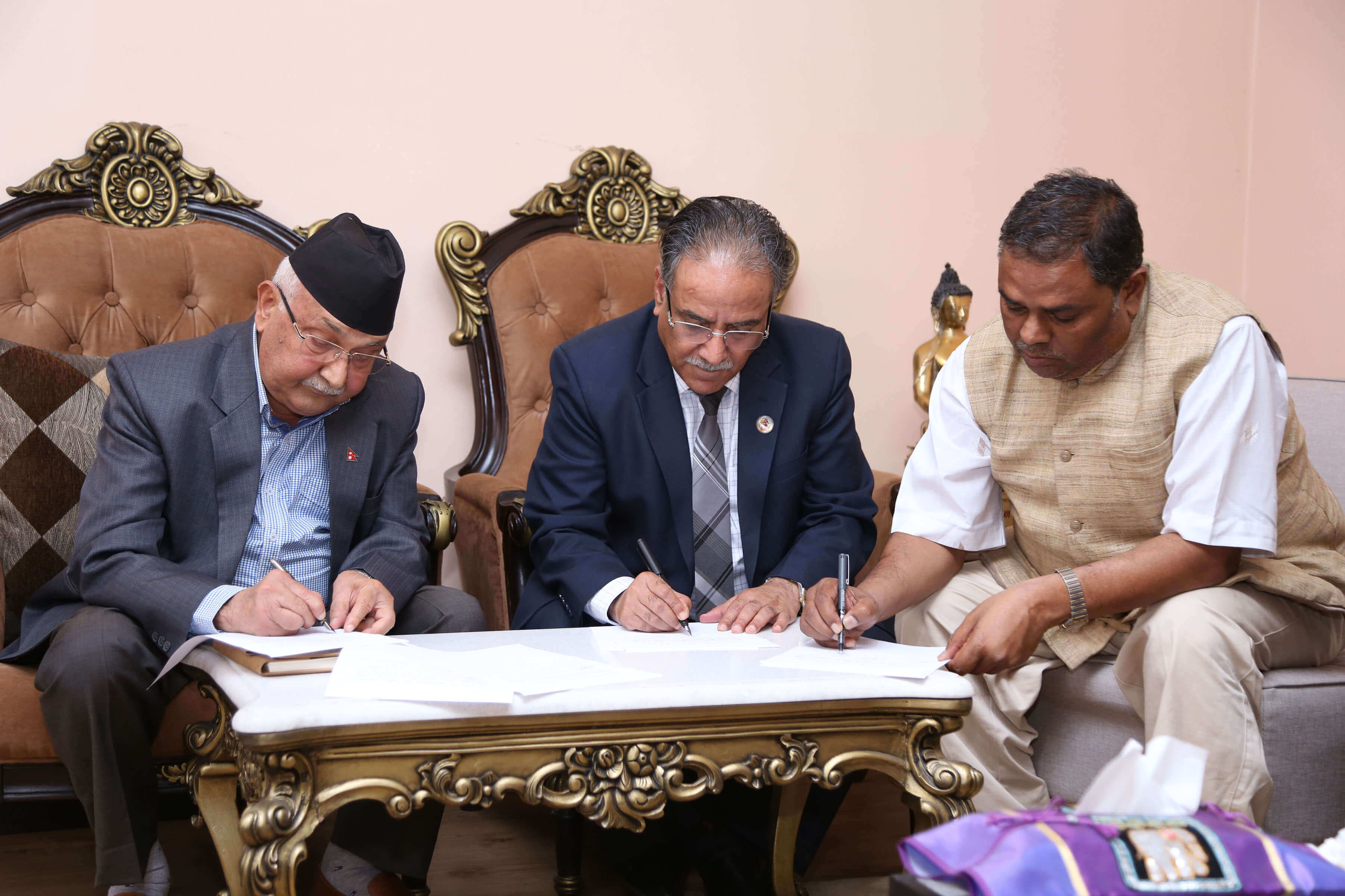 Prime Minister KP Oli, co-chair of Nepal Communist Party Pushpa Kamal Dahal and Upendra Yadav of Sanghiya Samajbadi Forum Nepal (SSFN) sign two-point agreement on Monday. SSFN has decided to join the government following the agreement.
