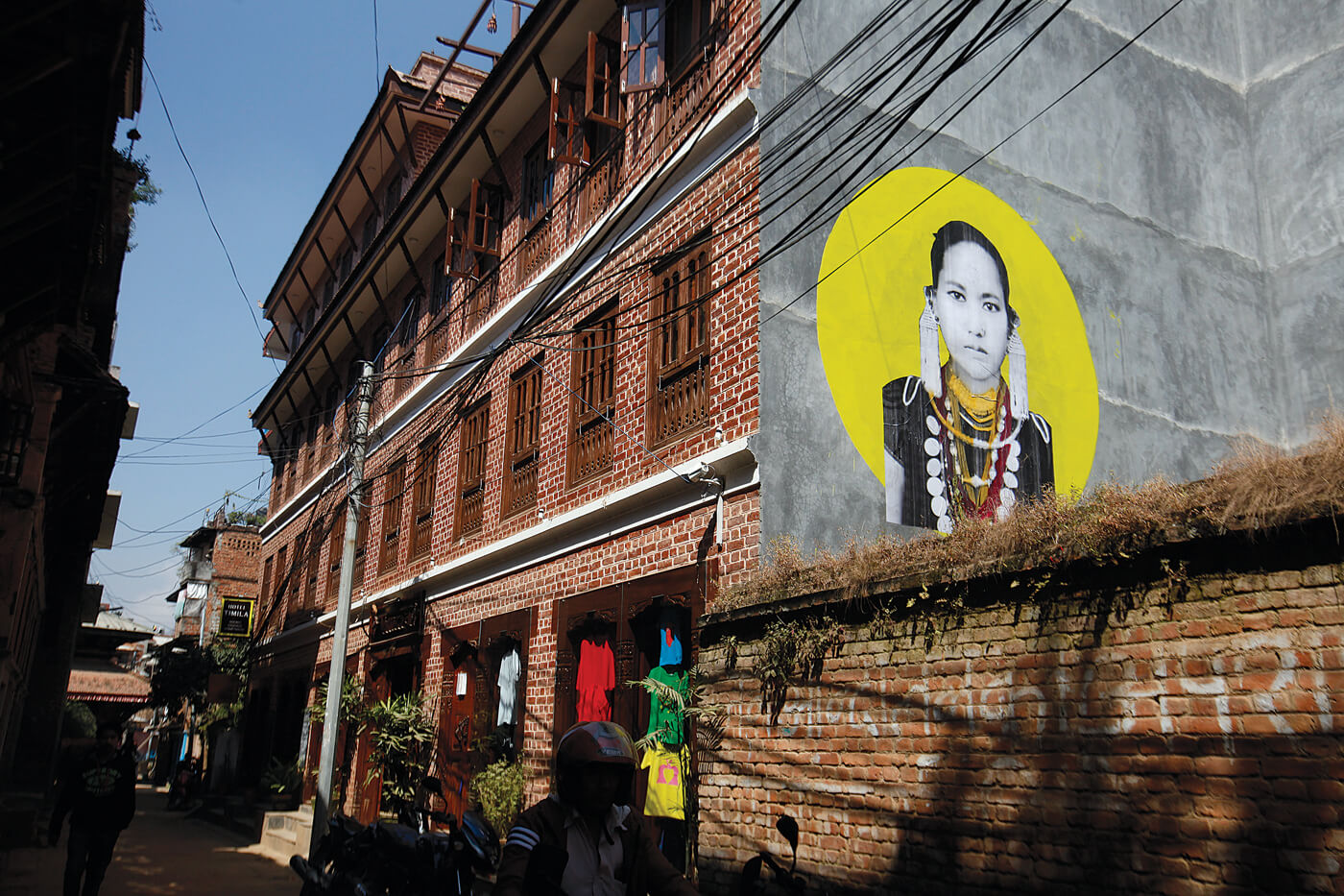 Photo returns to Kathmandu