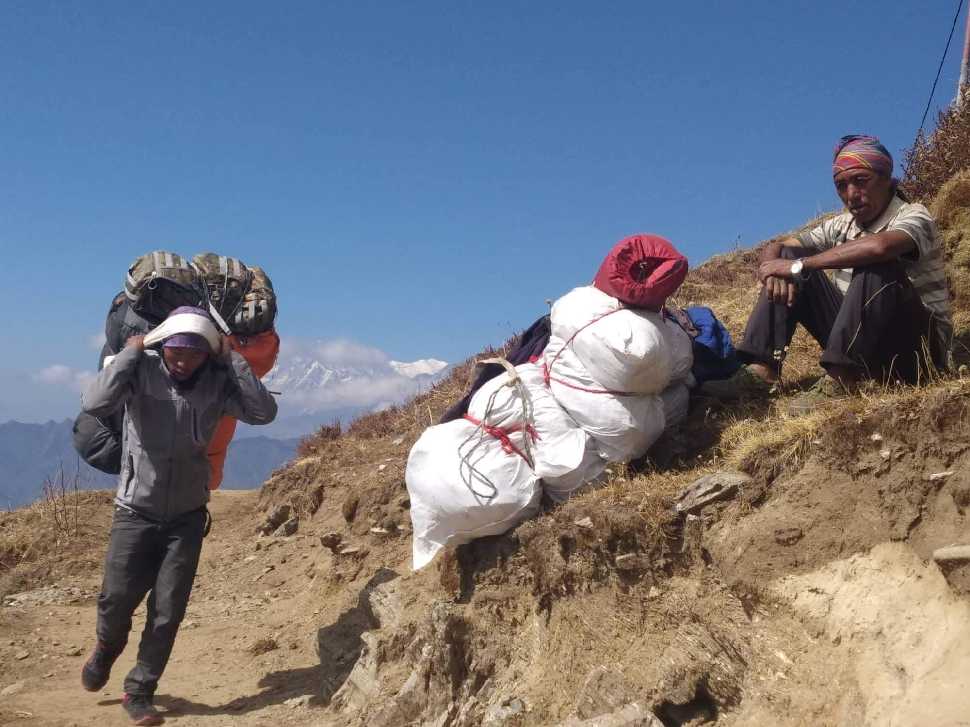 Porters and tourists make their way to Khopra Danda, Myagdi. Thousands of Nepalis are employed as porters and guides in the tourism industry and end up missing Dashain and Tihar festivals, which fall during the peak trekking season of autumn.