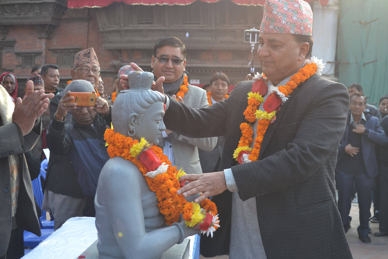 Deputy Prime Minister and Minister of Defence Ishwor Pokhrel pays his respect to Sankhadhar Sakhwa before starting a rally to welcome the Newari New Year Nepal Sambat 1139 in Basantapur on Sunday.
