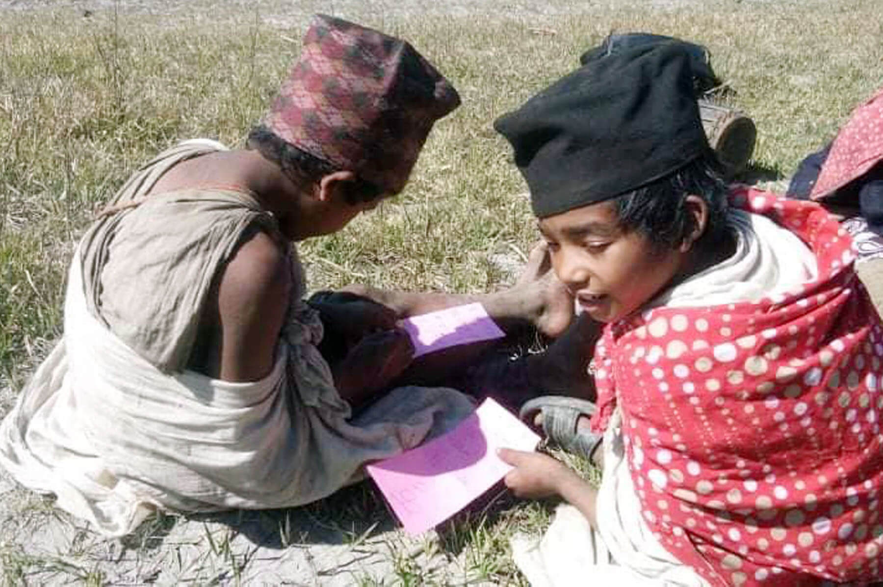 Children of nomadic Raute community practice writing and drawing in Lekbesi municipality of Surkhet. Rautes are becoming attracted to education of late.
