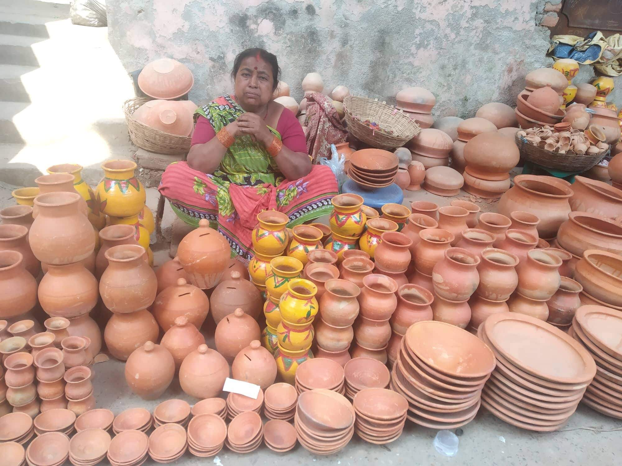 Women sell traditional pottery in Birgunj on Wednesday, some With holi decorations.