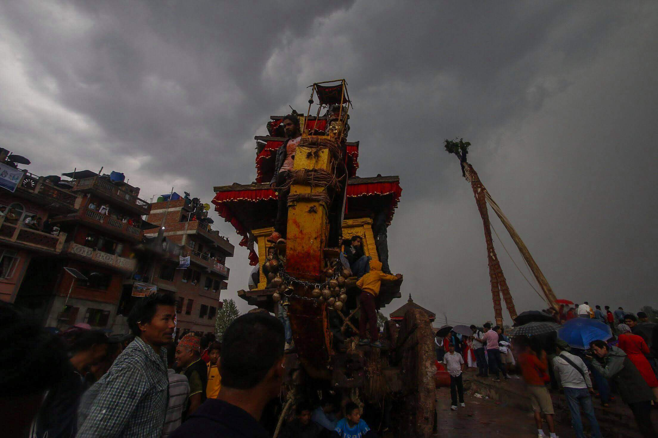 People of Bhaktapur celebrate the 5th day of Bika Jatra in Bhaktapur, despite rain. The yoshin dyo or pole that was erected on the previous day is pulled down on the day of the New Year, whereas the chariot of Bhairab is taken back to Gahiti.