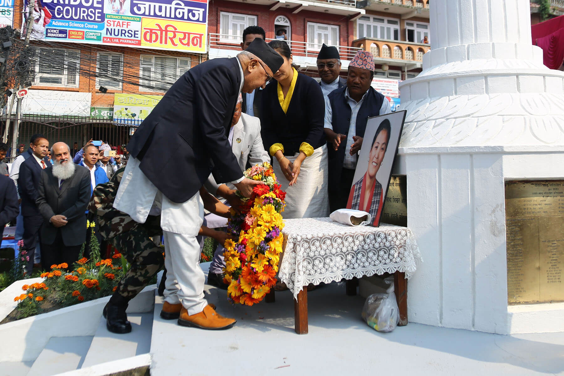 Prime Minister K P Oli pays his respect to the late Pasang Lhamu Sherpa at a ceremony marking the 26th memorial of the mountaineer in Kathmandu on Tuesday.