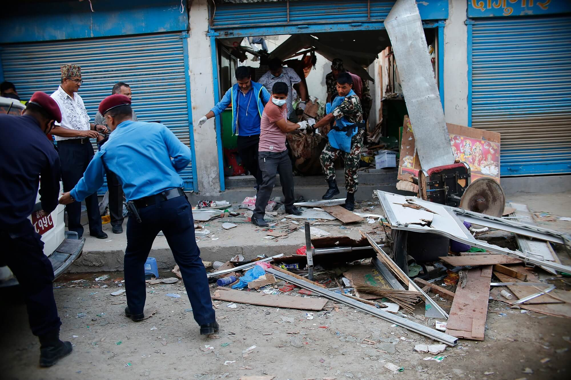 Officials inspect the explosion site in Sukedhara, Kathmandu on Sunday afternoon. Three people were killed in two separate blasts in Ghattekulo and Sukedhara and five were left injured.