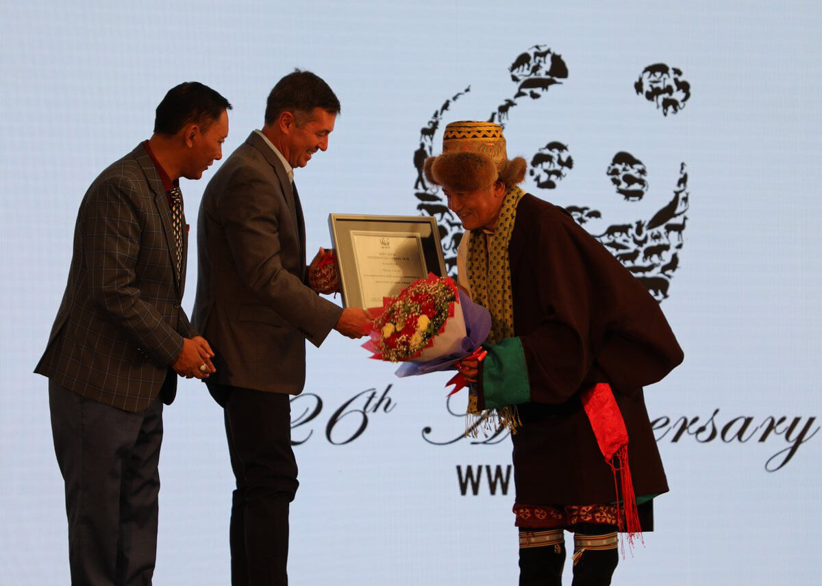 US Ambassador Randy Berry presents an award to Nima Lama for his conservation work as a community leader in Manaslu region during the 26th anniversary of WWF Nepal in Kathmandu on Sunday.