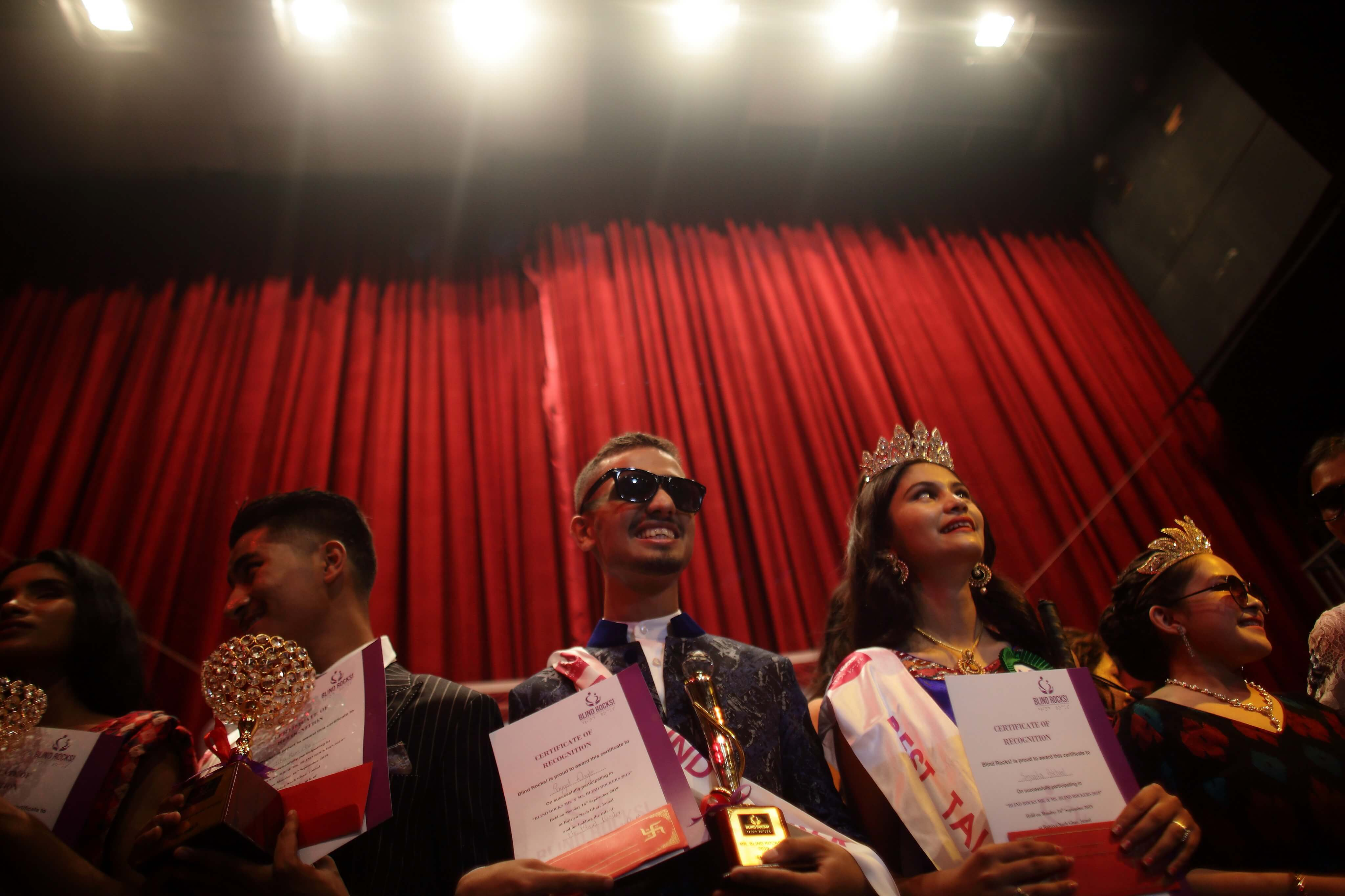 Saugat Wagle and Smarika Pokhrel (third and second from left) after being crowned Mister and Miss Blind Rocks 2019 at Nachghar, Kathmandu on Monday.