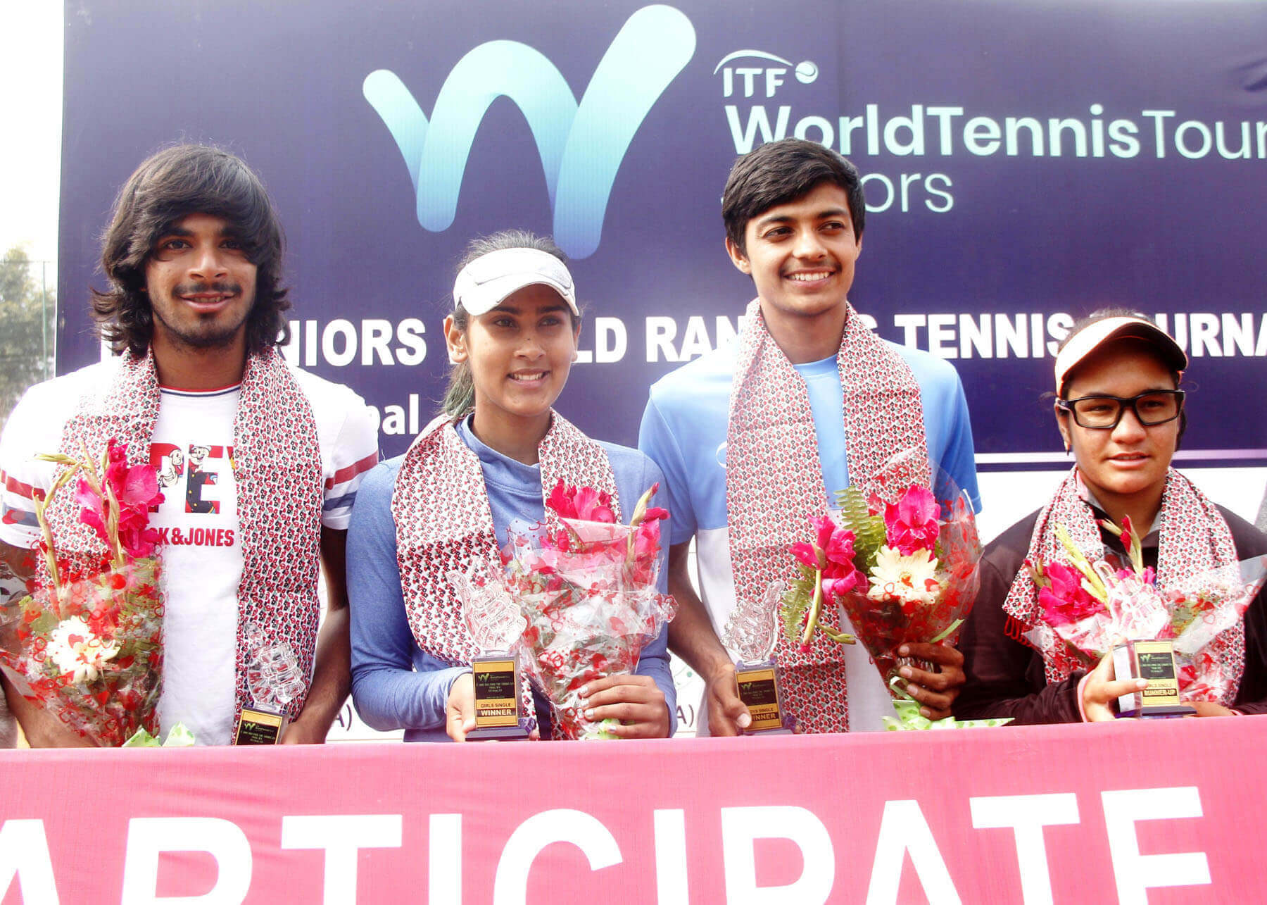 Winners of Internal Tennis Federation Juniors U-18 Tennis Tournament held in Pokhara pose for a group photo on Saturday. Nepal's Prerana Koirala emerged victorious in women's single category by defeating a fellow Nepali Avilasha Bista.