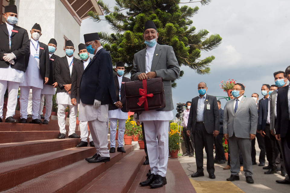 Finance Minister Yubaraj Khatiwada on his way to deliver Nepal's annual budget in which he announced setting aside Rs 6 billion for coronavirus control and management.