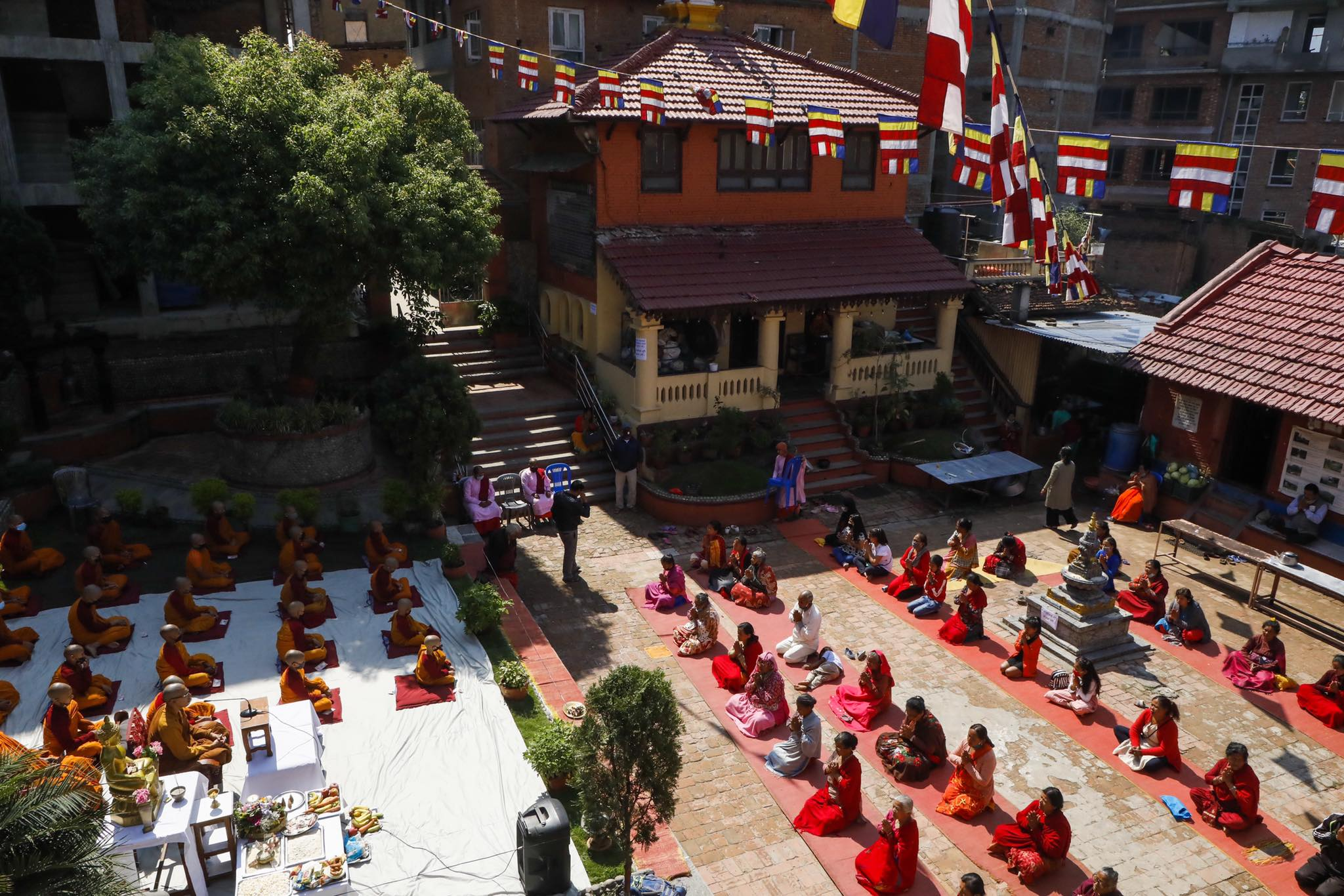 Despite the nation-wide COVID-19 lockdown, worshippers for prayers maintaining physical distance to celebrate the auspicious occasion of the Buddha's 2,564th birthday in Kathmandu on Thursday.