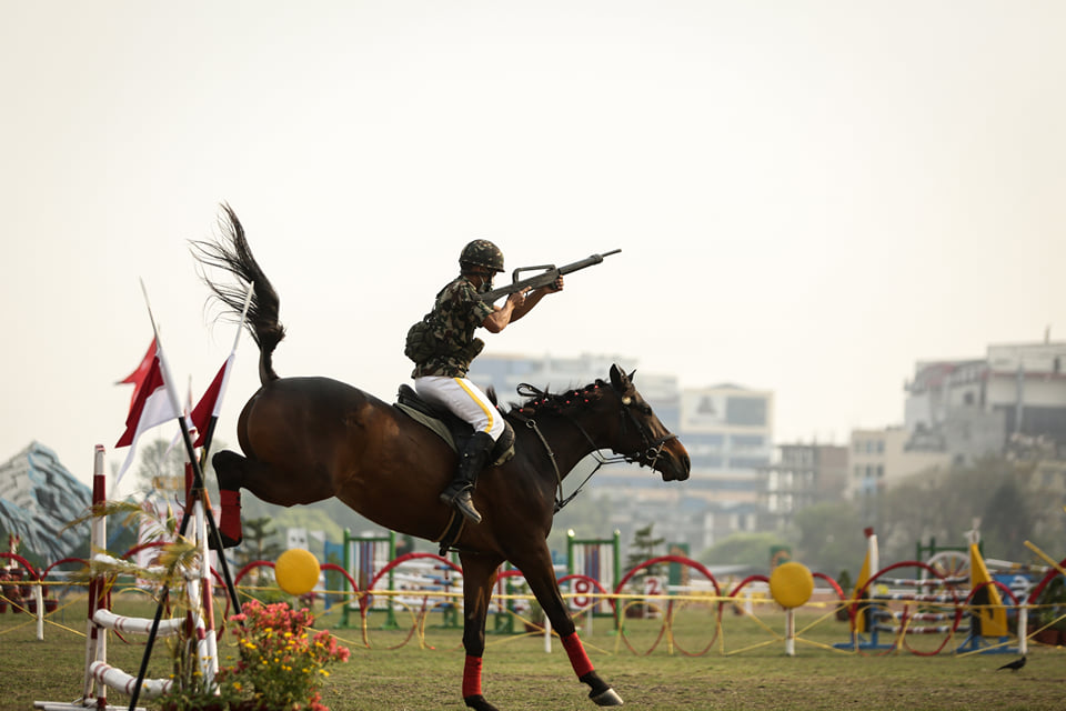 A Nepal Army equestrian with a trained horse performs obstacles in an event to mark Ghode Jatra festival in Kathmandu on Sunday.