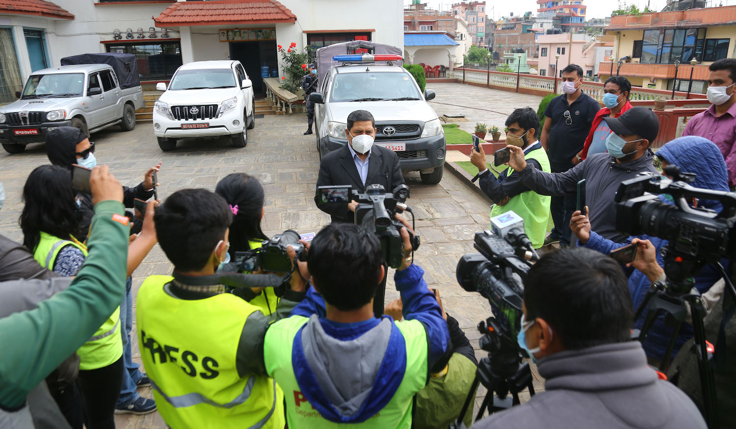 Narayan Kaji Shrestha of the Maoist Centre speaks with the media following the party's withdrawal of support for the UML in Kathmandu on Tuesday.