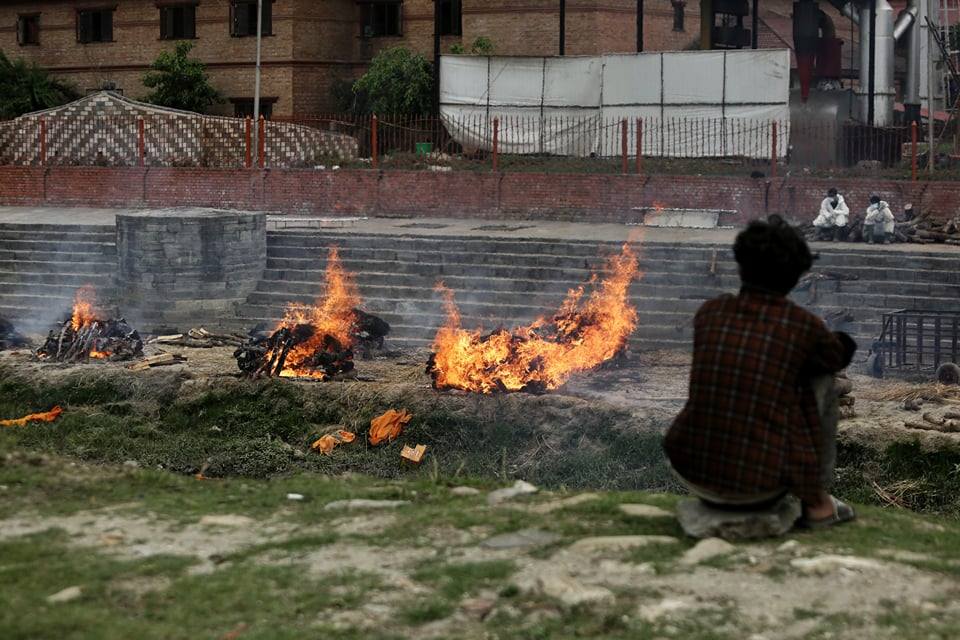 Nepal Army arrange pyres for those who succumbed to Covid-19 on the banks of the Bagmati. Kathmandu's only electric crematorium at Pashupati has not been able to handle bodies even while running round the clock, while one of the two incinerators at the crematory has broken down.