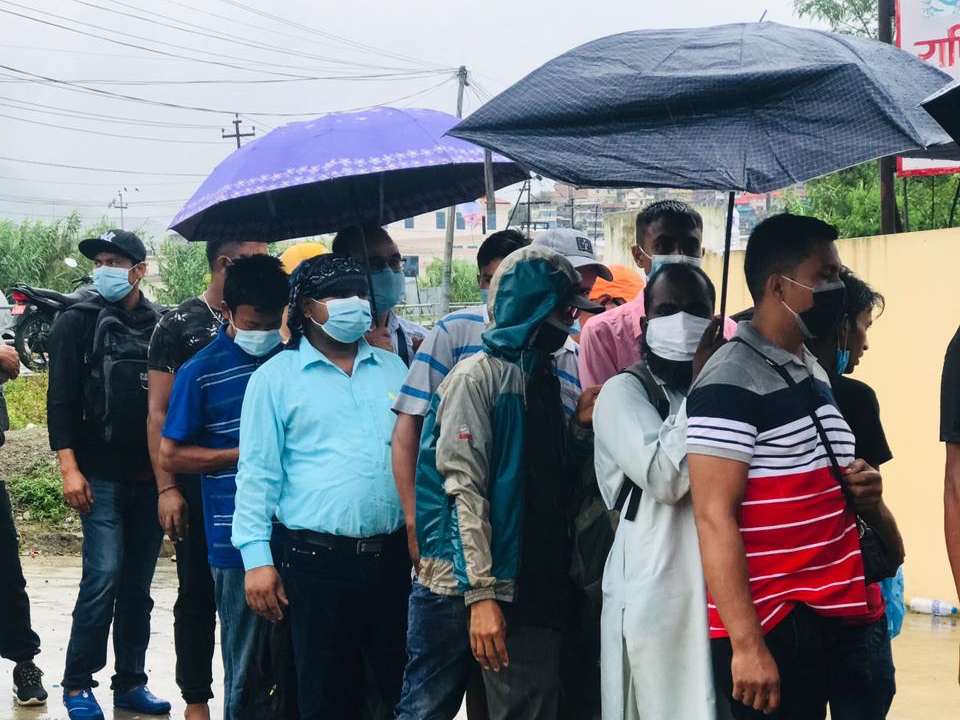 Nepali workers queue up for QR codes